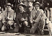 Burnham in Africa (middle) holding his Remington Model 1875 No. 3 Army in .44WCF rifle