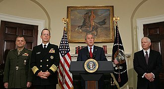 Michael Mullen - President George W. Bush (at lectern) announces the nominations of Mullen (second from left) and James Cartwright (far left) to be Chairman and Vice Chairman of the Joint Chiefs of Staff, respectively, on June 28, 2007, at the Roosevelt Room of the White House.