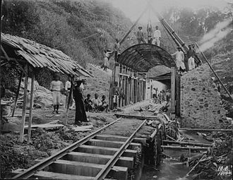Dutch East Indies - Workers pose at the site of a railway tunnel under construction in the mountains, 1910.