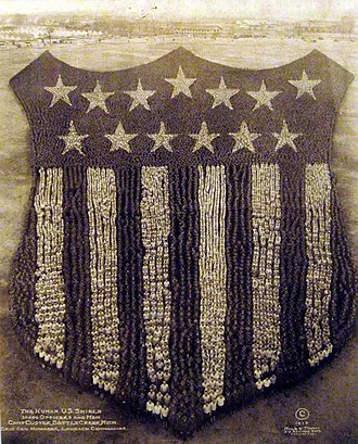 """Fort Custer Training Center - """"The Human U.S. Shield,"""" 30,000 officers and men, at Camp Custer, Michigan, World War I, (1918)."""