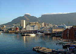 The Victoria & Alfred Waterfront in Cape Town with Table Mountain in the background. Cape Town has become an important retail and tourism centre for the country, and attracts the largest number of foreign visitors in South Africa.