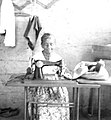 Caption- 1964. This Native Christian, second oldest member of the Mennonite Church in Araguacema, does sewing in her home to support herself. (8250777600).jpg