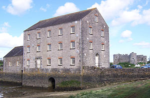 Carew Castle - The tidal mill at Carew, with the castle in the background