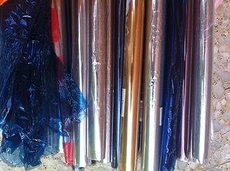 Cellophane - Cellophane can come in any color and is used in packaging different products in grocery stores.