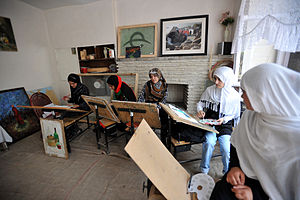 Culture of Afghanistan - Women painting at the Center for Contemporary Arts Afghanistan (CCAA) in Kabul.