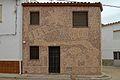 Cervera del LLano, casa con fachada de conchas.jpg