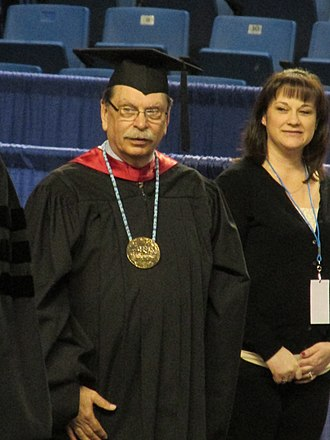 Brian D. Rogers - Brian Rogers (left) in May 2014, presiding over UAF's commencement ceremony.