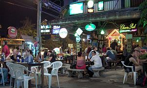 Tourists Sit Outside A Bar In Chiang Mai, Thailand
