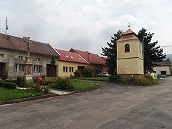 Center of the village with belfry and cross
