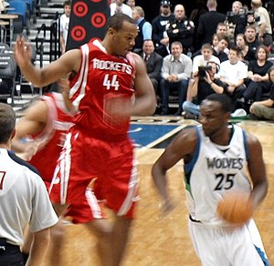 Al Jefferson - Jefferson driving against Chuck Hayes of the Houston Rockets.