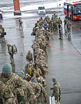 Coalition personnel depart on last camber flight at TCM 140221-F-VU439-192.jpg