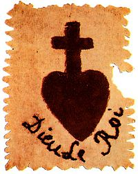 A black cross supported by a heart