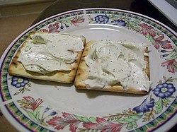 Cream crackers with cheese spread.jpg
