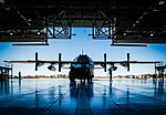 Crew chiefs with the Wyoming Air National Guard's 153rd Maintenance Group tow an aircraft inside a hangar.jpg