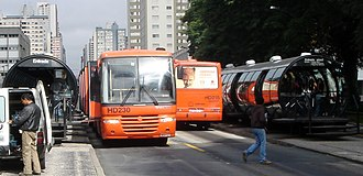The Rede Integrada de Transporte in Curitiba, Brazil, was opened in 1974. The RIT was inspired by the National Urban Transport Company of Peru. Curitiba 04 2006 06 RIT.jpg