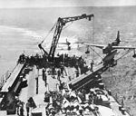 Curtiss SO3C returns to USS Biloxi (CL-80) in 1943.jpg