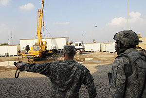 Containerized housing unit - Containerized housing units being moved in a US Army installation in Baghdad during 2008