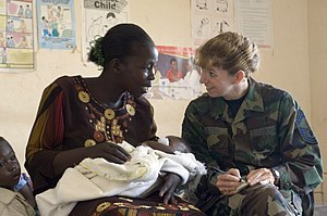 311th Human Systems Wing - An international health specialist of the 311th Human Systems Wing speaks with a woman in Uganda during exercise Natural Fire 2006.
