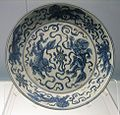 Dish with underglazed blue design of 2 lions playing a ball, Jingdezhen ware, mid 15th century, Shanghai Museum.jpg