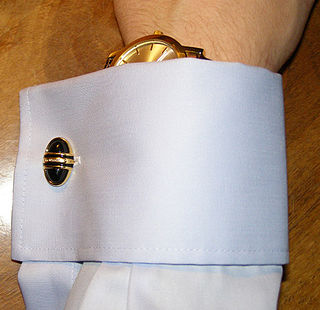 Cufflink jewelry used to secure the cuffs of dress shirts