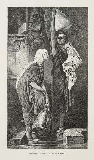 Women in Egypt - Two women holding large water jugs. One is carrying an infant (1878)