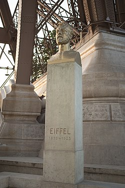 Eiffel bust under Eiffel Tower.jpg