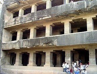 Vihara - Cave 12, Ellora, a late multi-story rock-cut vihara.  Further decoration of the pillars was probably intended.