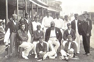 Johnny Tyldesley - England team v. Australia, Trent Bridge 1899.  Back row: Dick Barlow (umpire), Tom Hayward, George Hirst, Billy Gunn, J T Hearne (12th man), Bill Storer (wkt kpr), Bill Brockwell, V A Titchmarsh (umpire).  Middle row: C B Fry, K S Ranjitsinhji, W G Grace (captain), Stanley Jackson.  Front row: Wilfred Rhodes, Johnny Tyldesley.