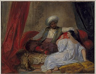 An Arab Smoking a Hookah with a Woman at His Feet