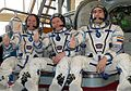 Expedition 31 backup crew members in front of the Soyuz TMA spacecraft mock-up in Star City cropped.jpg