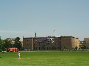 Fælledparken - Rescue helicopter from the Danish Air Force transports patient to Rigshospitalet. The big building is the headquarters of the Danish Order of Freemasons.