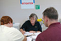 FEMA - 32259 - FEMA Mitigation specialist speaks with residents at an Ohio DRC.jpg