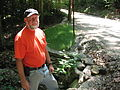 FEMA - 34289 - Road Agent Tim Fiske next to a repaired culvert in New Hampshire.jpg