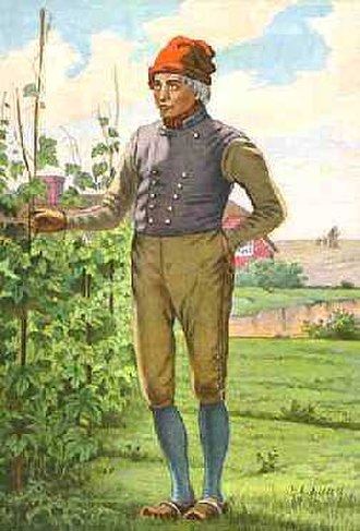Knit cap - Danish farmer wearing traditional clothing, including red tophue