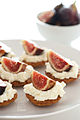 Fig tarts with whipped cream on a plate, March 2010.jpg