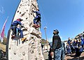 Flickr - Official U.S. Navy Imagery - Airman David Kamara spots a Japanese Boy Scout on the rock-climbing wall..jpg