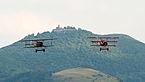 Fokker Dr.I D-EFTJ and Fokker D VII SE-XVO formation OTT 2013 01.jpg