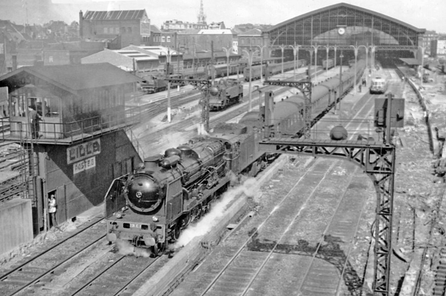 Express for Paris leaving Lille (Nord) Fives Station, with a SNCF class 231E 4-6-2 and passing the major Poste (signal-box) No. 8.