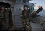 French sailors assigned to the visit, board, search and seizure (VBSS) team aboard the French Navy destroyer Jean de Vienne (D 643) communicate with their teammates aboard the guided missile destroyer USS Mason 140101-N-PW661-040.jpg