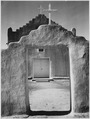 "Front view of entrance, ""Church, Taos Pueblo National Historic Landmark, New Mexico, 1942"" (Misicn de San Gercnimo) (ver - NARA - 519983.tif"