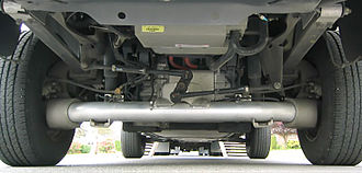 Ford Ranger EV - In the 1998 model, carbon fiber leaf springs support a DeDion tube located by a Watt's linkage, motor/transmission is attached to chassis. Later versions have similar appearance but without the linkage