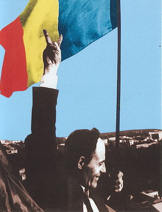 Moldova - Deputy Gheorghe Ghimpu replaces the Soviet flag on the Parliament with the Romanian flag on 27 April 1990.