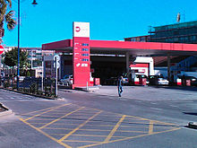 A petrol station forecourt viewed from across the road
