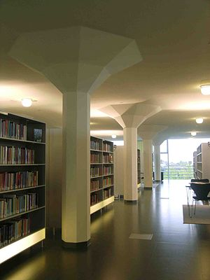 Glaspaleis - The interior of the Glaspaleis library, featuring the building's mushroom-shaped pillars.