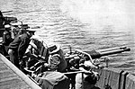 Gunnery practice aboard USS Hollandia (CVE-97), in 1944.jpg