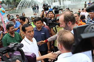 Joko Widodo - Jokowi meeting visitors to Jakarta near the well-known Selamat Datang Monument in Central Jakarta