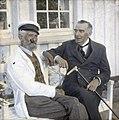 Håndkolorert dias. Portrett av to eldre menn, dikteren Vilhelm Krag og antakelig Morten Langfeldt, sittende på en hvitmalt benk. Krag er kledd i dress og holder en spaserstokk i hånden. Langfeldt har (9471830210).jpg