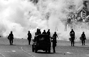 Riot police use teargas and water cannon to br...