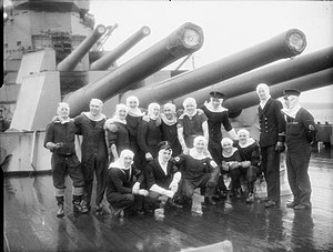 Members of HMS Duke of York‍ '​s gun crews at Scapa Flow after the Battle of North Cape.