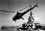 HO3S takes off from USS Columbus (CA-74) at Naples c1951.jpg